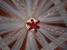 Love the ceiling decor!.....minus the red thing in the middle