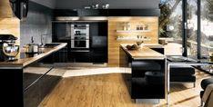 Cuisine bois et noire - Un mélange esthétique de bois et de noir laquée.