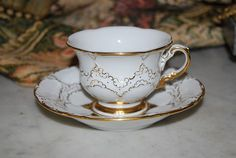 MAGNIFICENT MEISSEN HP WHITE AND GOLD CABINET FOOTED  DEMITASSE CUP & SAUCER