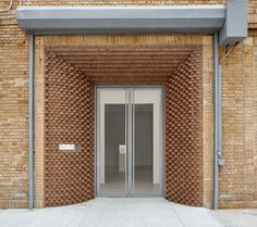 Brooklyn studio SO-IL creates a brick corbelled entryway for an art gallery in New York's Chelsea neighbourhood