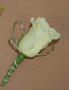 Ivory Rose Boutonniere and silver wire. Could use silver ribbon instead or navy blue and add blue berries for a little pop of color.