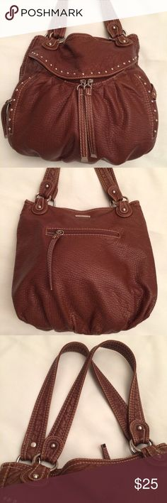 """Red by marc ecko Dusk Till Dawn Brown Studded Bag Red by marc ecko Dusk Till Dawn Brown Studded Shoulder Bag Medium Size. This item is in excellent condition. No signs of wear. Clean inside and out With studded details.  Mutiple Zip pocket is located on outside front & back of bag for quick access Interior Two slip and one zip pocket for convenience with Top magnetic snap closure Dual flat straps for easy carrying; Mid size; Color Brown; Silver polished hardware Measurements: H 14"""", W 14"""", D…"""