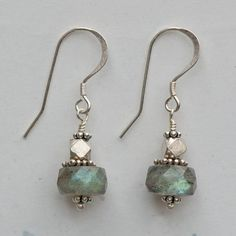 """Labradorite gemstone earrings. Iridescent labradorite faceted roundels and India sterling silver beads on sterling silver french hook ear wires. 1 1/2"""" long."""