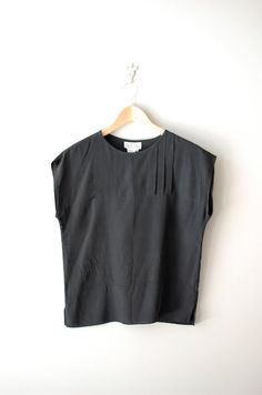 Black silk tunic blouse. I have a nice little collection of these in my closet. -Bre