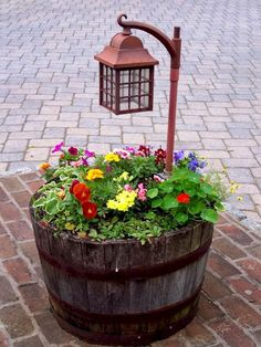 20 Fabulous DIY Garden Art Projects for This Spring 20 Fabulous Art DIY Garden Projects for This Spring - barrel planter with lamp post Outdoor Planters, Outdoor Gardens, Diy Planters, Log Planter, Fence Planters, Indoor Outdoor, Lawn And Garden, Garden Pots, Spring Garden