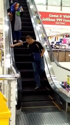This rat is having a great time terrifying people on an escalator   Credit: Vira...