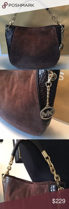🆕MICHAEL KORS NEW LARGE HOBO BAG 💯 AUTHENTIC MICHAEL KORS NEW NEVER USED WITH TAGS GRAINED SUEDE AND CROC LARGE HOBO BAG 100% AUTHENTIC . SO STUNNING AND STYLISH. TOTALLY ON TREND HOT BAG! SO MANY BEAUTIFUL DETAILS TO THIS BAG. 5 INTERIOR WALL POCKETS IN A LARGE ROOMY MAIN COMPARTMENT. BAG HAS A ZIP TOP. THIS BAG MEASURES ALMOST 15 INCHES WIDE AND 12 INCHES TALL. THE SHOULDER STRAP HAS A 7 INCH DROP. AS WITH ALL SUEDE IT CONTAINS A NATURAL LOOK Michael Kors Bags Hobos