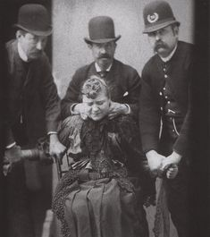 ca. 1890, [police force a woman to have her mugshot taken]