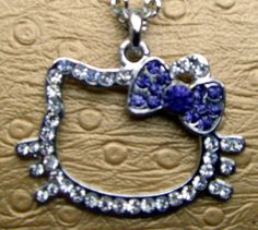 Hello Kitty** Larger Crystal Pendant Purple  bow....I would wear this!!
