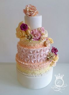Pastel Frills  Flowers Beautiful Wedding Cake Photo Visit http://www.brides-book.com for more great wedding resources