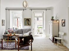 It doesn't all have to be white!  Artikel, Scandinavian Apartments, via My Scandinavian Home