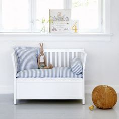Nautical nursery - white bench with striped cushions