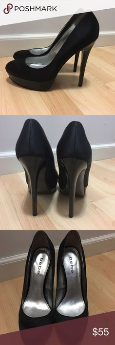 Bebe Bailey Black Satin High Heel Pumps These pumps are amazing.  Black satin with leather lining and leather outsoles, black patent leather platform and 5.5 inch heels.  Very good condition. bebe Shoes Heels
