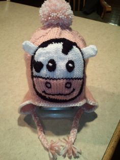 Hand knitted cow hat!  Hat is based on the sock monkey hat pattern I purchased on Etsy.  The face was created from looking at a picture on the interent!
