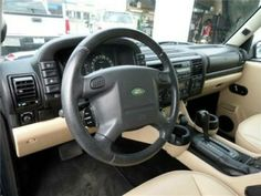 2003 Land Rover Discovery S tan interior with BLACK STEERING WHEEL.