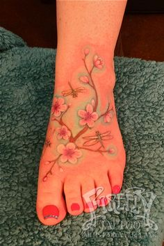 My finished tattoo! Now I'm thinking of adding more to it.... cherry blossom dragonfly foot tattoo