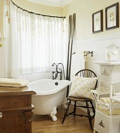 Cottage-Style Curves- Bathtub placement is a good way to deal with an awkward room shape. For example, by placing this claw-foot tub in front of a curved wall of windows, the homeowners wasted no space. In fact, the curve of the tub plays handsomely off the shape of the wall.