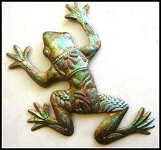 "HAITI METAL ART ...  February Sale – 10% discount View our huge selection of hand cut, recycled steel drum metal art. Click to view all ....  https://www.etsy.com/shop/HaitiMetalArt  Metal Frog, Outdoor Metal Art, Metal Wall Decor, 17"", Outdoor Garden Art, Metal Wall Art, Iridescent Finish, Haitian Metal Art,- 7702-17-IR by HaitiMetalArt on Etsy"