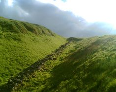 The remains of the Antonine Wall. The Antonine Wall was the northernmost barrier of the Roman Empire and ran for approximately 39 miles across the central belt of Scotland. It was abandoned after only 20 years when Roman soldiers retreated to Hadrian's Wall. Not very strategic - Why would you build a wall in a gully?