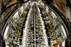 US and Canadian soldiers fill the cargo area of a USAF C-17 Globemaster III 2012 [4194 x 2796]