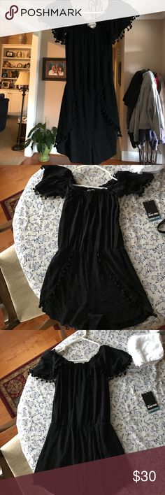 Black romper Really cute black romper with ball decorations on the sleeves. From versona. Worn twice. Like new. I think maybe one or two of the balls broke off but nothing noticeable. versona Other