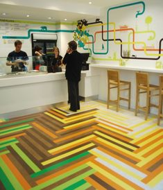 Makes it clear where to stand in the floor graphics. Poncho No.8 by Something from Us, funnovative!