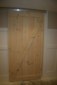 homemade barndoor for bunkhouse. Good ideas 1. use closet door glide kit from Home Depot for $12.  2. Make door from pallets, possible plywood? 3. get floor guide from Home Depot keeps the bottom of the door in place. 4. Get handles that match size of door