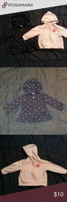 2 Carter's Hoodies One is navy blue fleece with silver dots. Other is thinner and pink with white stripes and pretty flower. $7 each Carter's Shirts & Tops Sweatshirts & Hoodies