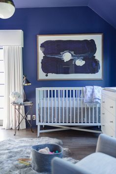 Tiffani Thiessen's newborn's blue nursery with white crib