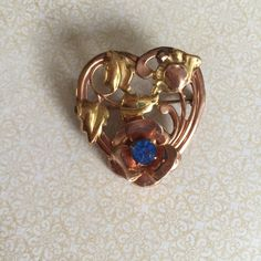 A personal favorite from my Etsy shop https://www.etsy.com/listing/452839866/vintage-gold-filled-heart-with-faux