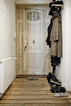 i am in love with this door! love the vintage white and worn look with detailed wood work.