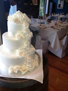 Cascading white roses wedding cake at Immerse