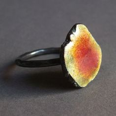 Enameled sterling silver geode ring in bright yellow and deep pink by Smashing $98