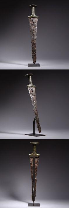 Ancient Near Eastern Early Iron Age Iron & Bronze Sword - 900 BC www.ebay.com/itm/Ancient-Near-Eastern-Early-Iron-Age-Iron-Bronze-Sword-900-BC-/390609802643