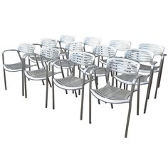 Set of 12 Aluminum Toledo Chairs Designed by Jorge Pensi for Knoll | From a unique collection of antique and modern armchairs at https://www.1stdibs.com/furniture/seating/armchairs/