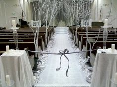 I like this, line the aisle with the trees and candles on the floor~EP