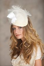 Hand made Lisa Shaub Fine Millinery fascinator constructed from horsehair and grossgrain ribbon.