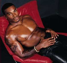 oh Tyson Beckford - my first black guy crush - was on my wall from a magazine when I was in high school. (Not this sexy photo, though ...)