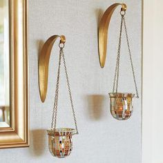 Vienna Sconce Set. A mingling of metallics creates a high-fashion, designer look! Set of two shimmering mosaic glass sconces reflects the tones of platinum and champagne.