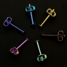 These tiny Anodized Niobium Post Earrings are perfect for sensitive ears. The head of the posts measure 2mm and are 12mm long. They are made from 21 gauge niobium. The coordinating backs are made from titanium....so these are all hypoallergenic! YOUR CHOICE Natural Silver Vintage Bronze Dark Purple Dark Blue Steel Blue Yellow Peach Pink Bright Purple Bright Blue Green Custom Mix of Colors - Let me know in the notes to seller when you check out. Black - the backs will be a grey-silver tone