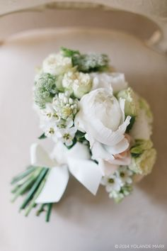 Classic white bridal bouquet by Flowers in the foyer. Photo by Yolande Marx