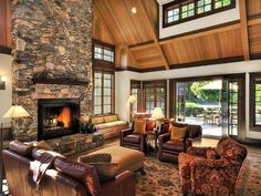 Craftsman Living Room with Paint, Casement, can lights, stone fireplace, Cathedral ceiling, Hardwood floors, Fireplace