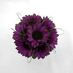 Purple sunflowers and I want to add white Gerber daisies to match the bridesmaids flowers