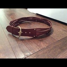 Linea Pelle Wide Leather Belt Great thick, loosely overlapping belt, perfect for cinching your favorite cardigan or dress. You can really see the rich chestnut leather and the small dark brass studs in the vertical pic. Only worn a few times, great condition. Linea Pelle Accessories Belts