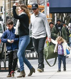 Doting dad: The 38-year-old NFL star followed behind the stunner with the couple's daughter Vivian, three and Tom's son Jack Moynahan-Brady