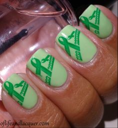 I wonder if I could get these for my campaign this year and use for awareness?! green ribbon Nail Designs | Traumatic brain injury.