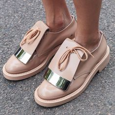 Fashion flats with laces. Pink leather shoes.