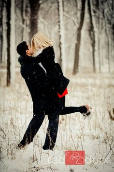 Winter Engagement Photos. The touch of red it really cute.