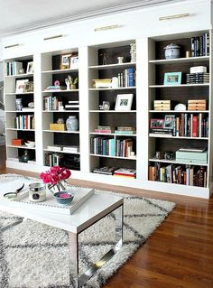 Create the look of built ins with IKEA bookcases, she expertly use moldings to hide electrical, etc....mdb