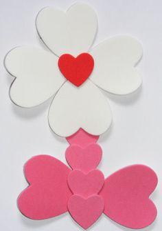 Esta florzinha delicada pode ser montada com diversos materiais, desde papel até eva. É necessário apenas recortar corações de dois ...